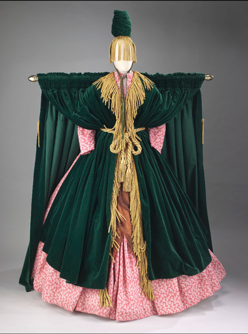 "Costume designed by Bob Mackie for Carol Burnett, who wore it during a skit on her comedy variety TV show. A spoof on Gone with the Wind, the skit was called ""Went with the Wind"" and the characters' name was Miss Starlett."