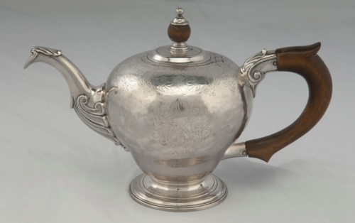 This silver teapot with a wooden handle was made around 1750 by Samuel Casey of Little Rest (later Kingston, Rhode Island) for Abigail Robinson. It was probably made around the time of Abigail's marriage to John Wanton of Newport, Rhode Island, in 1752.
