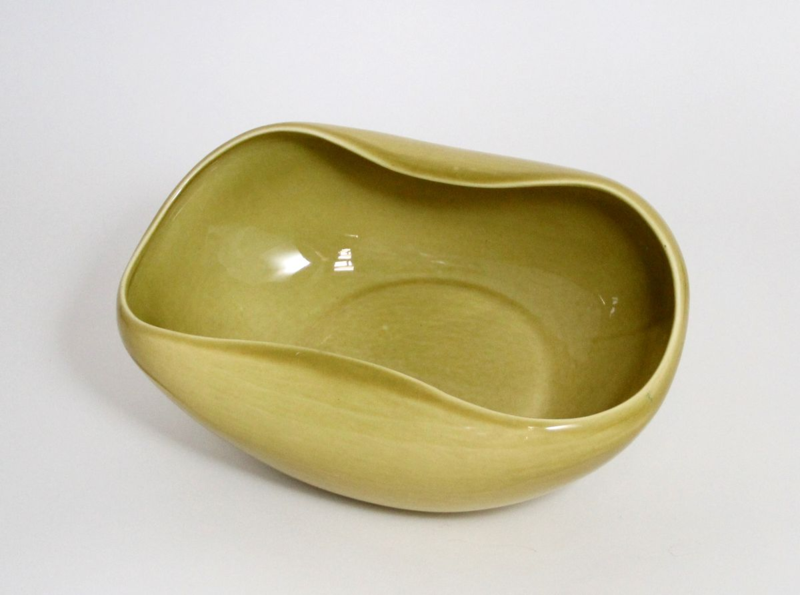 A salad bowl from the American Modern line, with its distinctive Chartreuse Curry glaze, designed by Russel Wright and manufactured by Steubenville Pottery