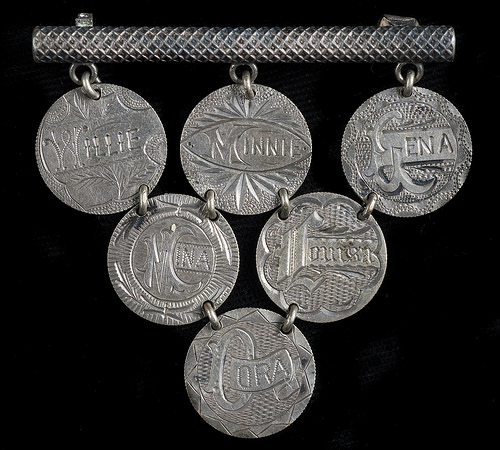 Although the pieces are all linked together, the design on each token is one-of-a-kind. NU*247633.01.