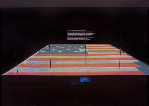 The Star-Spangled in its protective chamber. The flag is on display in Flag Hall of the National Museum of American History.