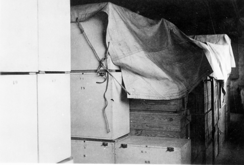 In this photo from the Smithsonian Archives, Smithsonian collections are crated and covered with a tarp to be transferred to a storage facility in Luray, Virgina, for safekeeping during World War II. [sirismm.si.edu-siahistory-imagedb-96-1361]