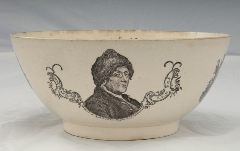 This creamware bowl has a transfer print depicting Benjamin Franklin, based on the original engraving produced in France by Charles Nicholas Cochin and Augustin de Saint Aubin in 1777