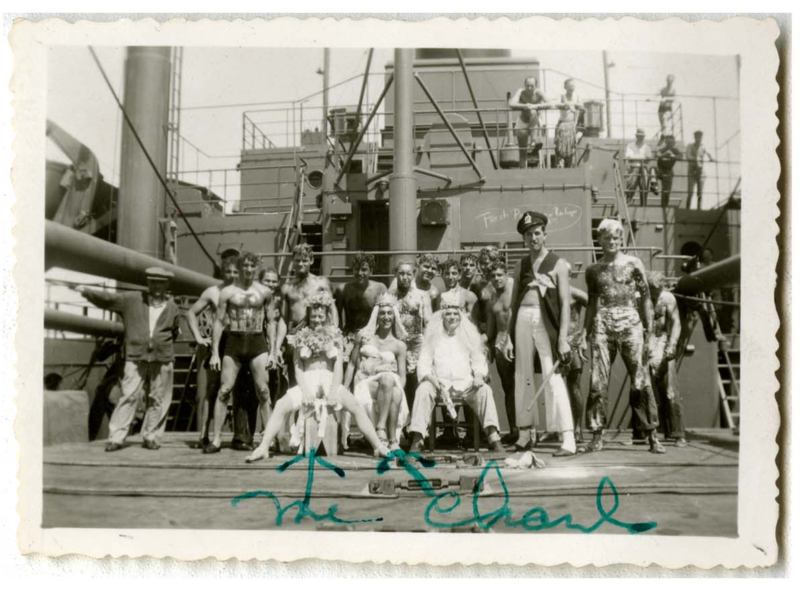 "A ""crossing the line"" ceremony on a U.S. Navy vessel. Howard far left, seated. When a ship crossed the equator, all of the people of board (crew and/or passengers) who had never before crossed the equator before might have a visit from King Neptune, who made them do silly or even dangerous things, as sort of an equatorial hazing. They might be shaved with a giant wooden razor, or have a bucket of offal dropped on their head."