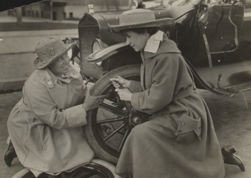 Margaret Whittemore and Margery Rose campaigning for suffrage in California, changing a tire on their car in 1916. Courtesy of Sewall-Belmont House & Museum, home of the historic National Woman's Party.