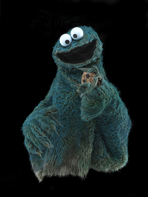 "Cookie Monster, a live hand puppet, was created in 1966 for a skit that aired on ""The Ed Sullivan Show"" and was used as a cast member of ""Sesame Street."" He is made of blue synthetic fur, foam, and plastic and was originally performed by Frank Oz."