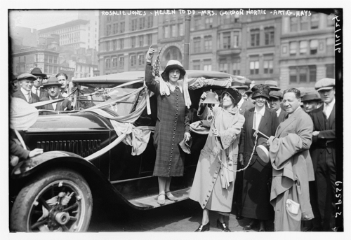 Rosalie Jones (center) greeting a crowd with fellow suffragists. Courtesy of Library of Congress, Prints & Photographs Division [LC-DIG-ggbain-37542]