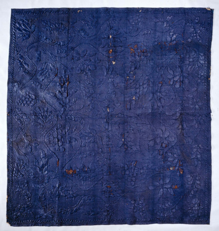 Indigo Wool Quilt, 1800-1815. The fabric for this quilt was dyed blue with indigo, one of the oldest dyes used for textiles. Glazing, a process involving the use of a hot press on wool fabric, resulted in a smooth, lustrous fabric surface.