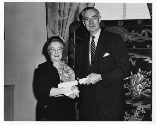 Secretary Leonard Carmichael makes Edna Little Greenwood an honorary Smithsonian Fellow, 1956. Courtesy of Smithsonian Institution Archives, negative number SIA2008-4348.