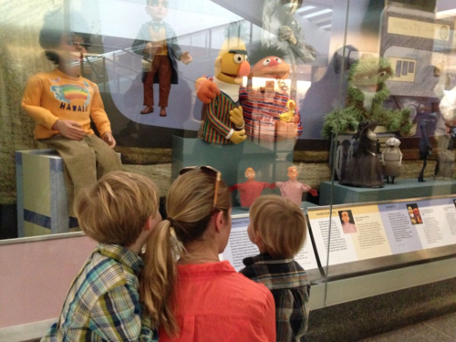 Kids enjoy the power of observation at the museum's short-term puppetry display.