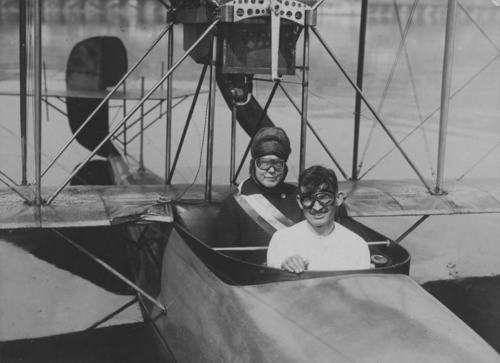 Lucy Burns and Lieutenant Maroney in hydroplane, Seattle, 1916. Courtesy of the Sewall-Belmont House & Museum, home of the historic National Woman's Party.