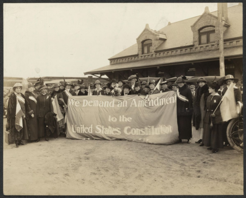 Suffragists on the Suffrage Special train arrive at the Atchison, Topeka, and Santa Fe Railway Company Depot in Colorado Springs, Colorado, 1916. Courtesy of Women of Protest: Photographs from the Records of the National Woman's Party, Manuscript Division, Library of Congress [mnwp.160081]
