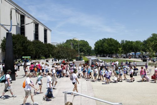 Summer visitors line up to enter the National Museum of American History in 2012