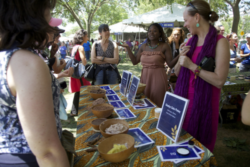 Demonstrating shea butter at the Smithsonian Folklife Festival 2011 on the National Mall. Image via Peace Corps.