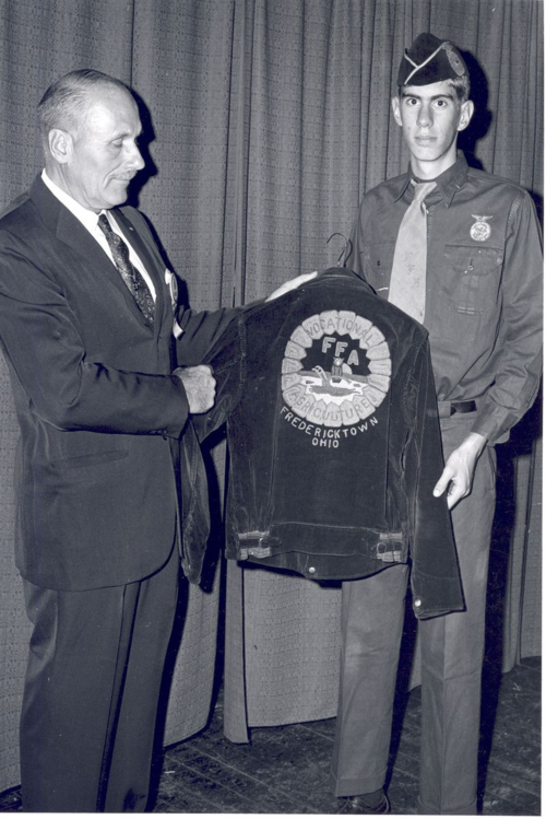 "Vocational agriculture instructor J. L. ""Gus"" Lintner from Fredericktown, Ohio, presented the first blue corduroy jacket to Ohio FFA nearly 20 years after its debut appearance during the 1933 National FFA Convention; the early version of the emblem did not include the eagle. Image courtesy the National FFA Organization."