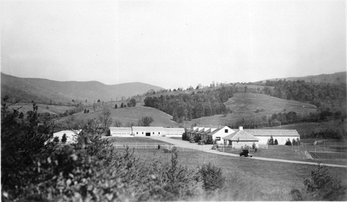 "According to the Smithsonian Archives, this October 1944 photograph shows ""The headquarters area of the United States National Museum storage facilityin Luray, Virginia, near Shenandoah National Park. On the back of photograph it states: ""Nat. Museum collections stored in building having dormer windows."" The square building in right foreground is the Guard Office. The museum collections were transferred to the storage facility for safekeeping during World War II"" Http---sirismm.si.edu-siahistory-imagedb-96-1343 (1)"