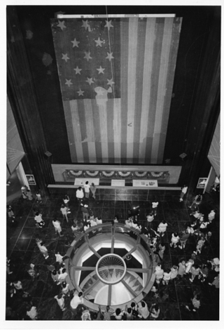 In this 1993 photo from Smithsonian Archives, the flag is shown inside the museum's center hall. Today, it's in a special low-light chamber where you can see it 364 days per year. Http---sirismm.si.edu-siahistory-imagedb-SIA2008-2449