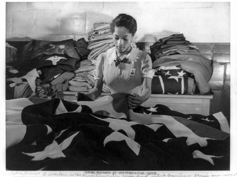 Making flags for military use in the quartermaster corps depot. 1942. Courtesy of the Library of Congress.