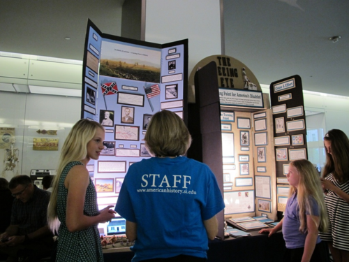 A student speaks with a museum staff member at National History Night 2013. Image courtesy of the Maryland Humanities Council.