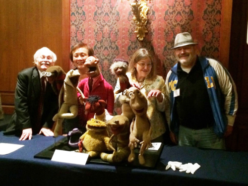 "Loo with Sam and Friends curator Dwight Blocker Bowers, Kate Martin, and Ted Martin at ""Behind the Scenes: Puppetry in America,"" in April 2014"