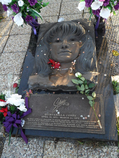 When news broke of Selena's shocking death in 1995, fans worldwide responded with a tremendous outpouring of affection and grief. For many U.S. Latinos, Selena—who was born in Texas, sang in Spanish, and spoke English—offered much-needed representation of the struggles of being a bicultural American. Pictured is her tombstone in Corpus Christi, Texas. Image from Wikimedia Commons