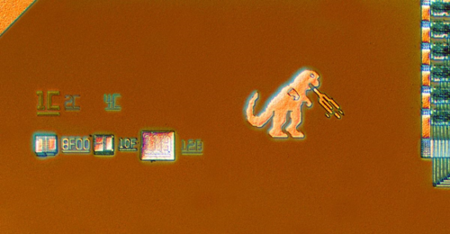 Back: This 21msp50/55/56 digital signal processor chip was created by Analog Devices Incorporated around 1994. The chip contains an image of a fire-breathing Godzilla. NMAH-AHB2012q12903