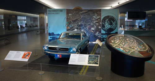 A 1965 Ford Mustang on display in the museum lobby