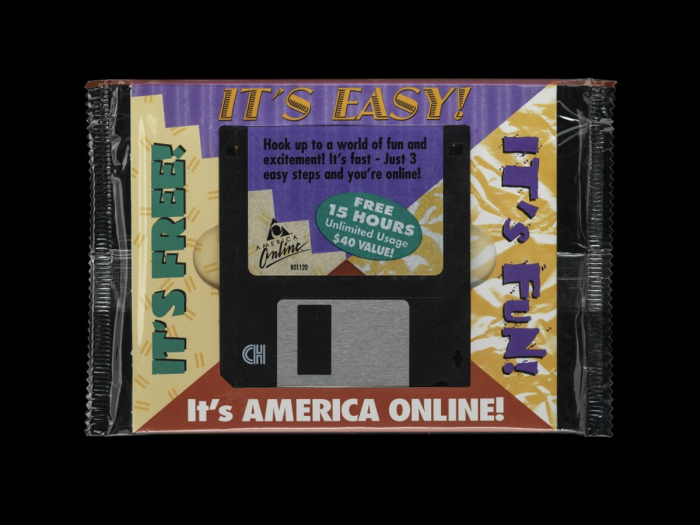 A floppy disk advertising AOL: It's free! It's easy! It's fun.