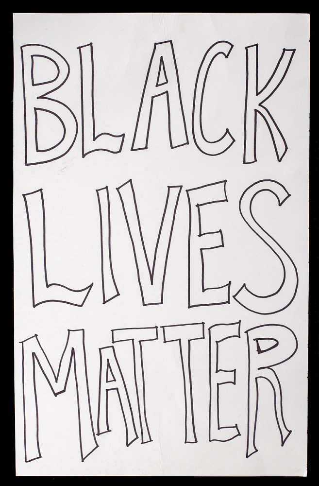 A poster that reads Black Lives Matter.