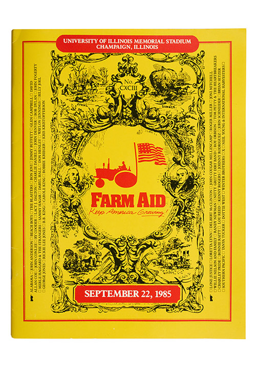 "A yellow program similar in layout to a farmer's almanac. In the center is a red silhouette of a tractor and the words ""Farm Aid."""