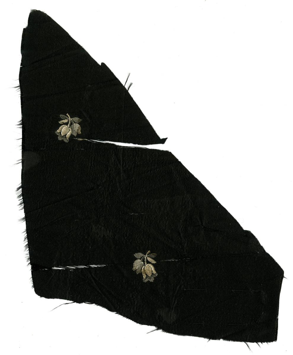 d65b74c4568 Scrap of black cloth with white flower designs