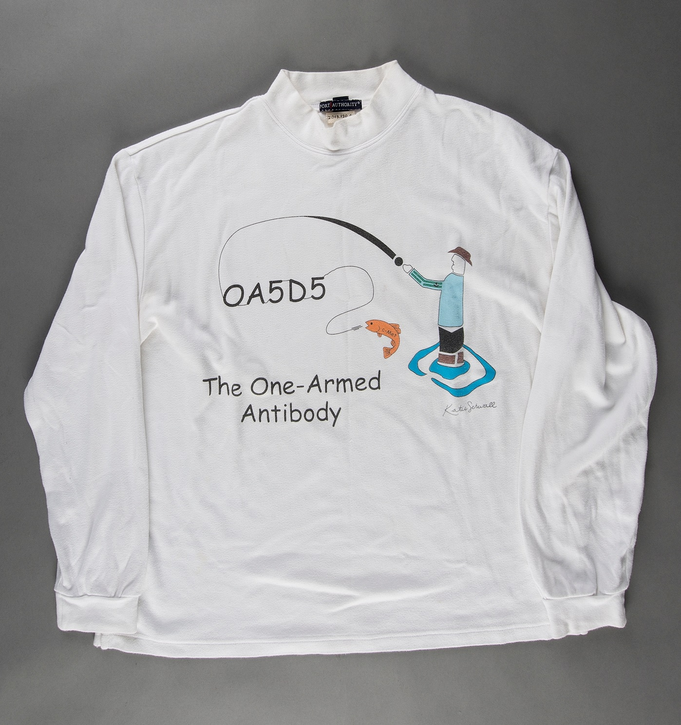 1e721e3f Juxtaposed image of a long-sleeved white tshirt with an illustration on the  chest and