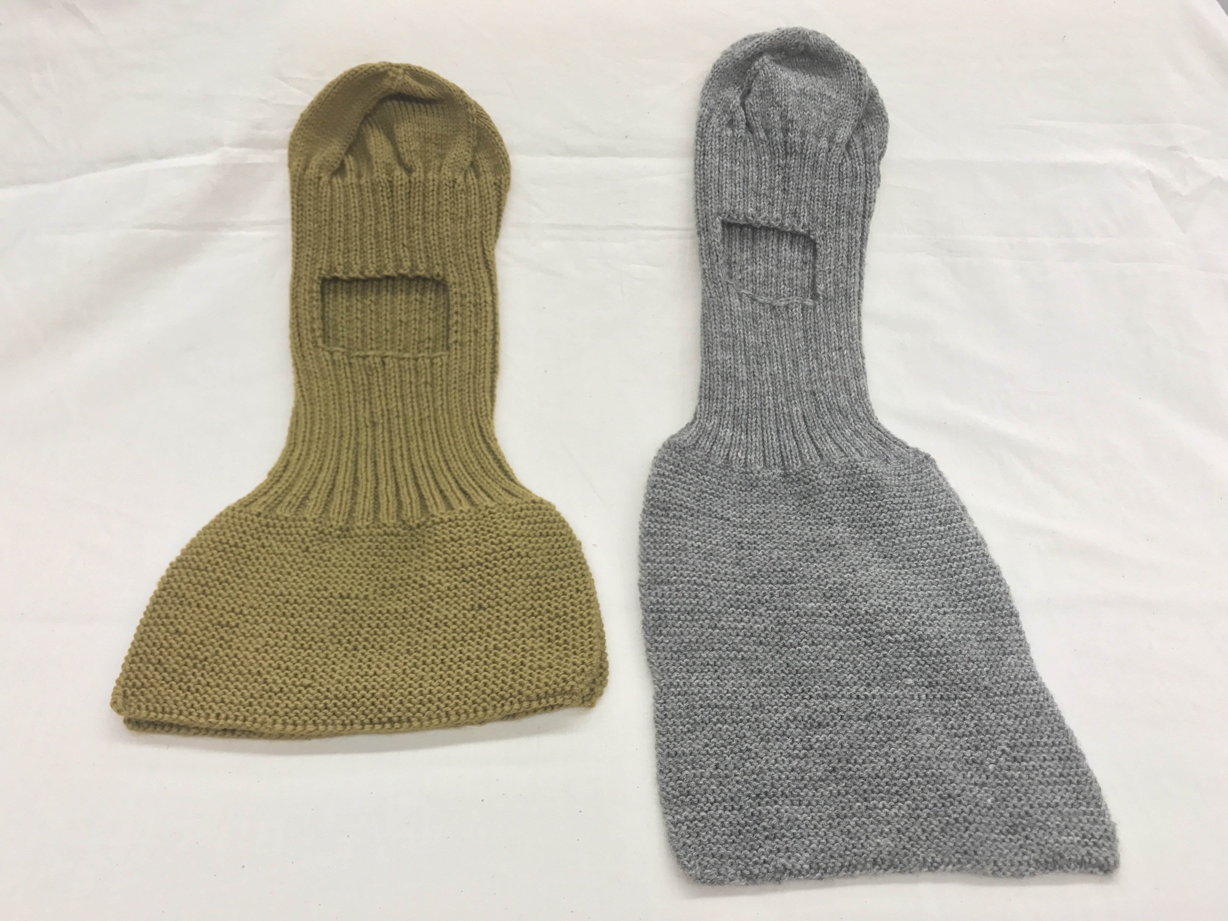 9ba8258e Knitted item in army green with space for your face to stick out