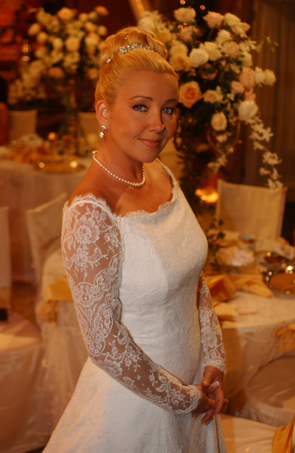 "wedding gown worn by actress Melody Thomas Scott as ""Nikki"" during one of her 12 weddings on the daytime drama, The Young and the Restless."