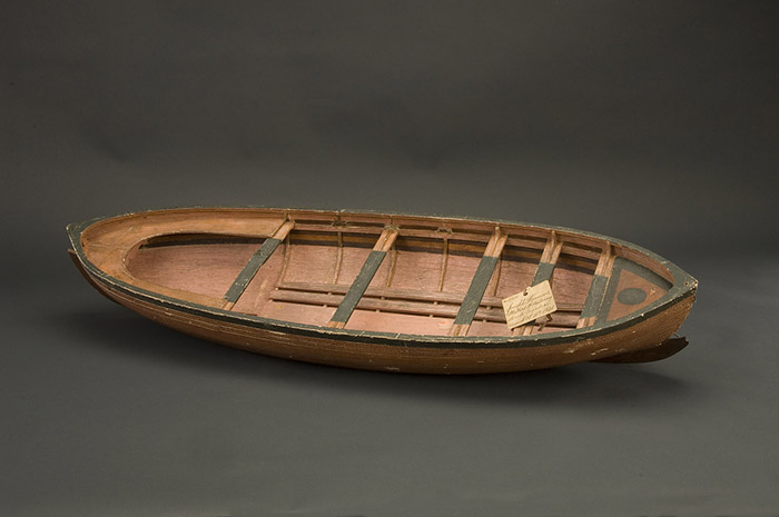 A patent model of a wooden boat.