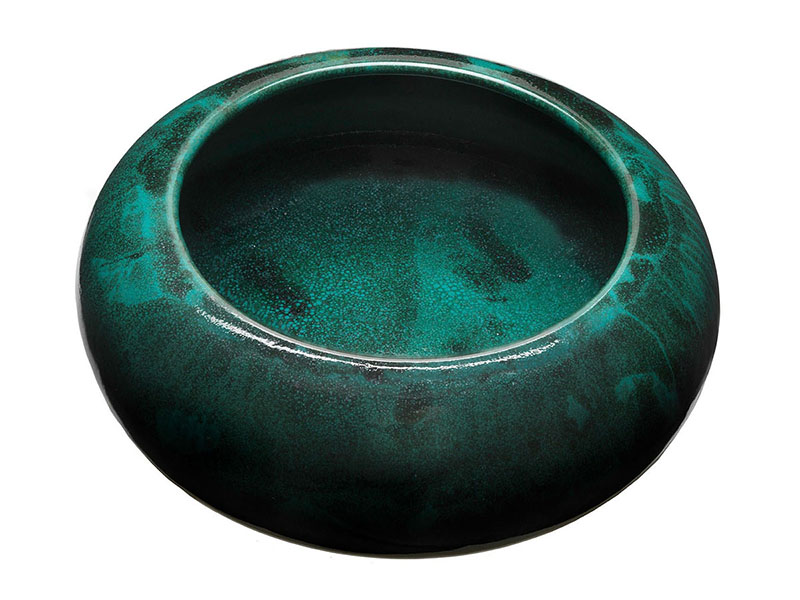Small globular bowl with wide open mouth. Glaze is turquoise with black striations and speckles. Made 1906–1942 by Paul Revere Pottery. 2 ¼ inches x 5 ½ inches.