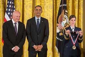 Harari receiving medal from President Obama
