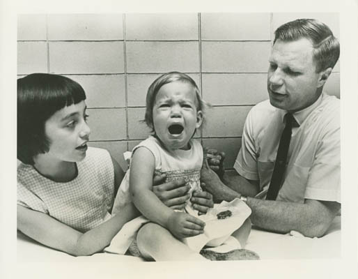 A 1966 photograph that accompanied Merck's press release about the successful vaccine depicted Jeryl Lynn comforting the crying Kirsten as the younger girl received her vaccination with the Jeryl Lynn Strain from Dr. Robert Weibel.