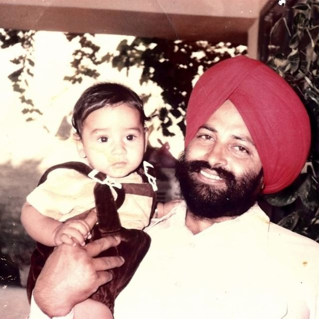 """In this photograph, Balbir Singh Sodhi holds his nephew and smiles at the camera.   Sodhi came to the United States at age 36, leaving behind limited economic opportunity and rising violence in his home in the Punjab region of India and Pakistan. However, instead of realizing the the American dream, Sodhi experienced a nightmare of hate and violence.   On September 15, 2001, a gunman shot and killed Sodhi while he planted flowers in front of the gas station he owned with his brother. His murderer saw killing Sodhi as an act of retaliation for the September 11 attacks days earlier. When arrested, the gunman proclaimed, """"I am a patriot"""" and told authorities that he wanted """"to kill a Muslim."""" Sodhi was not Muslim; he was Sikh (followers of a religion originating in northern India). The gunman sought to kill someone who, to him, looked like the photographs of Osama Bin Laden that had been widely shown on TV. He targeted Sodhi based on his beard, dark skin, and turban.   Sodhi's death is one of many examples of anti-Muslim and anti-immigrant rhetoric and violence in the United States following September 11."""