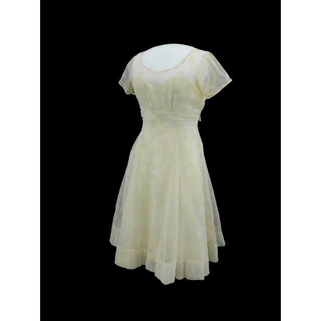 This dress belonged to Minnijean Brown Trickey, a member of the Little Rock Nine. Trickey was one of nine African American students who desegregated the Little Rock, Arkansas, high school in 1957—three years after the U.S. Supreme Court ruled segregated schools were unconstitutional in the landmark Brown v. Board of Education case.  Despite disruption resulting from the suspension from Central High School and the later closure of all of Little Rock's public schools to avoid integration, Minnijean graduated on schedule in 1959 from New Lincoln School in New York City. New Lincoln School was a private, integrated school from 1948-1988, known for its progressive educational methods.   This tea length white dress has a sheer white flocked floral pattern layer over a plain white underdress. The short sleeves are sheer, the skirt full, and the bodice fitted with a zipper and buttons on the back. Minnijean designed this dress herself, specifically for her graduation.  As part of this year's National Youth Summit, Minnijean will serve as a guest speaker as we examine issues of gender, bias, and equity through the lens of history. You can join our summit online for free. Register here: s.si.edu/nys  The National Youth Summit is made possible in part by support from the Smithsonian American Women's History Initiative.  This dress is currently on display in our exhibition, Girlhood: It's complicated.  Girlhood: It's complicated received support from the Smithsonian American Women's History Initiative  #AmericanHistory #WomensHistory #CivilRightsHistory #BecauseOfHerStory #YouthHistory #Girlhood #GirlhoodHistory #NationalYouthSummit