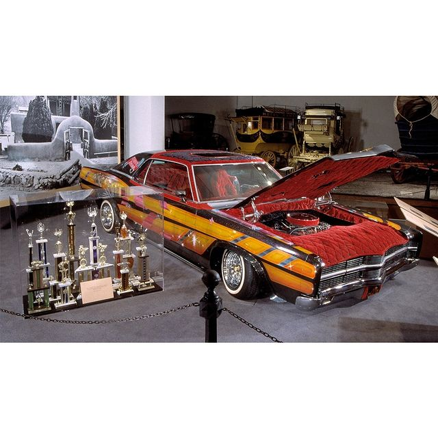 """David Jaramillo of Chimayo, New Mexico, began customizing this modified 1969 Ford LTD in the 1970s. Known as """"Dave's Dream,"""" the vehicle is a beloved example of Latino lowriders. Lowriding is a family and community activity with parades, trophies, and other events celebrating cars and paying homage to their power and beauty.   Artistic paint schemes and custom upholstery make each lowrider unique. Hydraulic lifts enable lowriders to hop, making them seem alive and animated. Sadly, Jaramillo was killed in an accident in another car, but his family and local artisans completed the modifications that he had planned, and the car often won """"first"""" or """"best in show.""""  This object is currently not on view.   #HispanicHeritageMonth #HHM #History #AmericanHistory #LatinoHistory #LatinaHistory #LatinxHistory #Lowrider #Lowriders"""