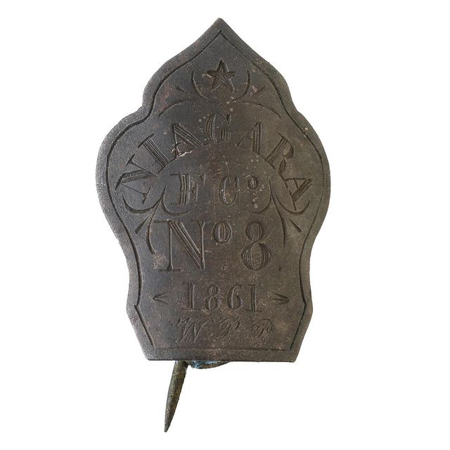"""Last year, this badge was discovered buried in the ground in Charleston, South Carolina. Though small, it's now helping our experts uncover a huge story: the histories of Black firefighters.   Before the Civil War, even as African Americans were often excluded from the ranks of firefighting companies in Northern cities, some Southern cities such as Charleston relied on Black firefighters. As our curator explains, beginning in the early 1800s, 'African Americans, both enslaved and free, organized around auxiliary pumpers, called 'ward engines,' meant to support white volunteer companies at fires. These ward engine companies were under the authority of white officers, but the men were issued badges and eventually uniforms and enjoyed some level of community status. They were even paid for their time assisting at a fire, though at a lower rate than their white counterparts, and enslaved men would likely have been expected to turn over their earnings.'   During the Civil War, Charleston struggled to maintain the ranks of its fire companies. Some of the free Black men who had served on ward engines decided to step in to fill the gap. In November, 1861, one group formed the Niagara Fire Company No. 8, an independent African American volunteer fire company. Their motto: """"Ever Ready."""" Others followed their example. When Charleston surrendered to U.S. forces in 1865, there were around 10 fire companies that marched along with Black military regiments in a celebratory parade.   Our curator believes that this badge belonged to William P. Perry, a local bricklayer who was just 17 years old when he decided to join the Niagara Fire Company. (Can you spot his initials, 'W. P. P.' on the badge?). Around 160 years after it was engraved, Perry's badge was discovered at a work site in the city, near where the company's firehouse once stood.   Follow the link in our bio today to learn more about this new object in our collection, as well as the larger history of Black firefighters in t"""
