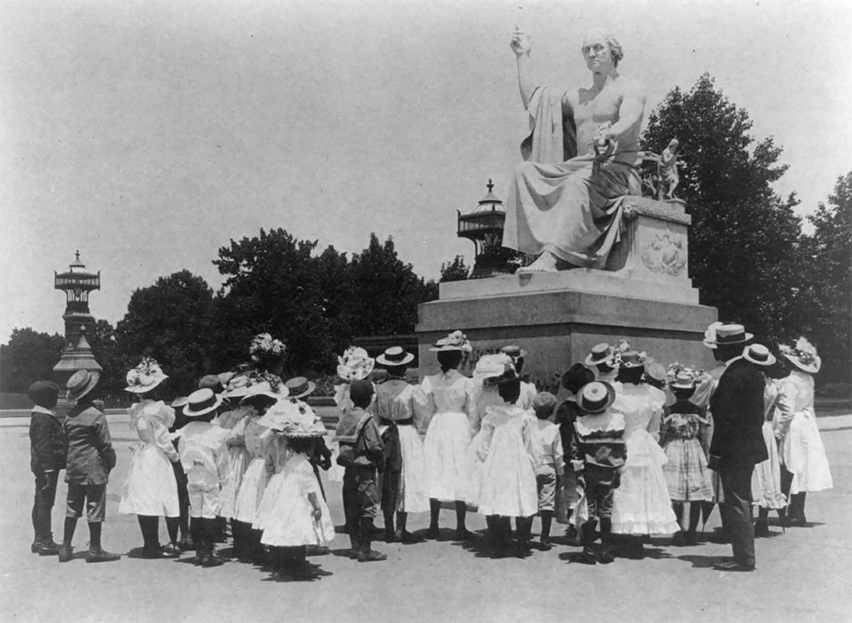 African American School children surround the statue of George Washington on the U.S. Capitol grounds, photograph by Frances Benjamin Johnston, around 1900 (Courtesy of Library of Congress).