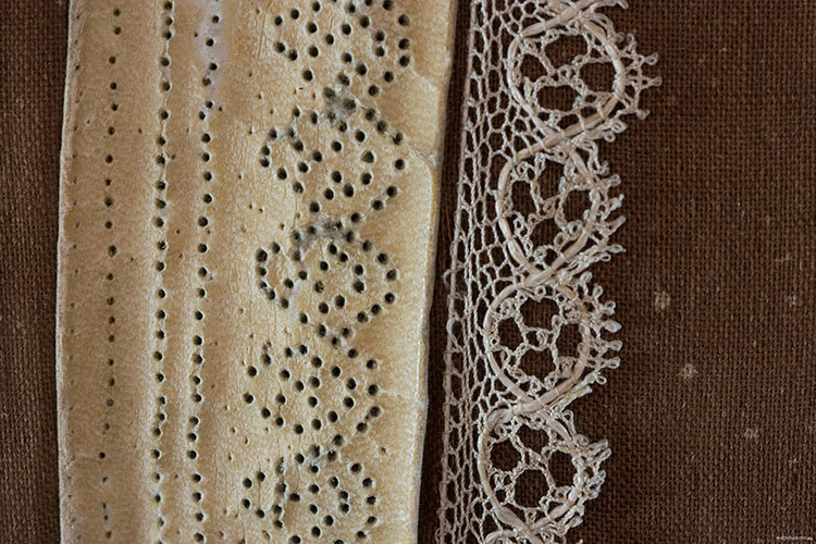 A detail of the lace being made