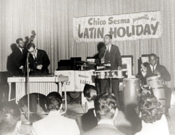 "(from right): Cla Tjader with Vince Guaraldi on piano, Al Mckibbon on bass, Willie Bobo on timbales, and Mongo Santamaria on conga drums at the Hollywood Palladium, late 1950s. Photograph courtesy of Lionel ""Chico"" Sesma."