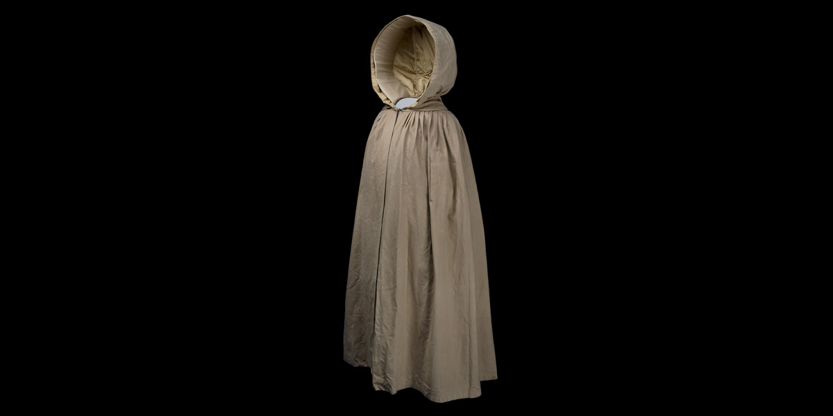 A taupe colored hooded cloak.