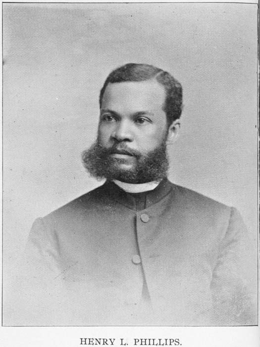 A portrait of an African American man in clerical clothes, with distinctive facial hair.