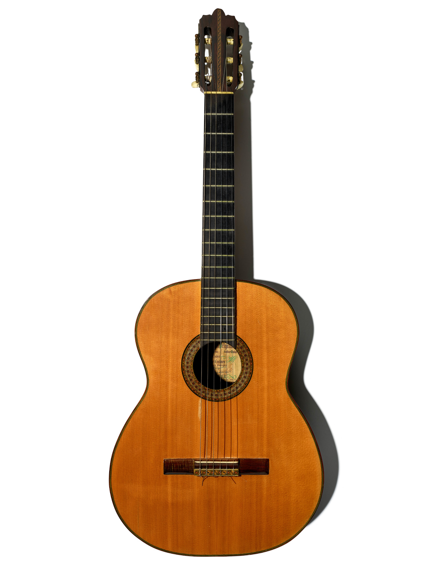A guitar posed vertically