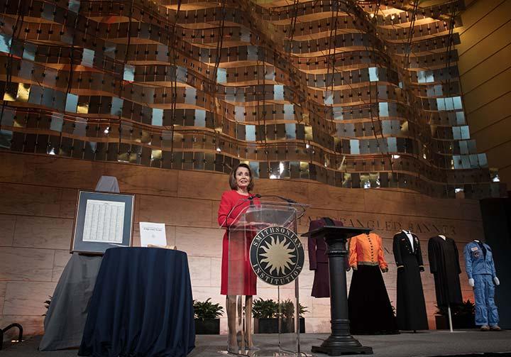 Nancy Pelosi at the podium