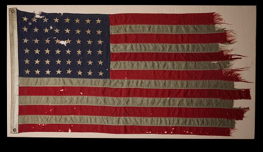 A tattered and frayed United States flag